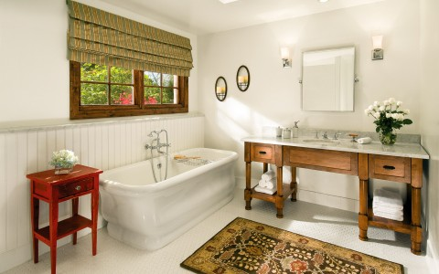 Bathroom with rustic vanity and bath tub