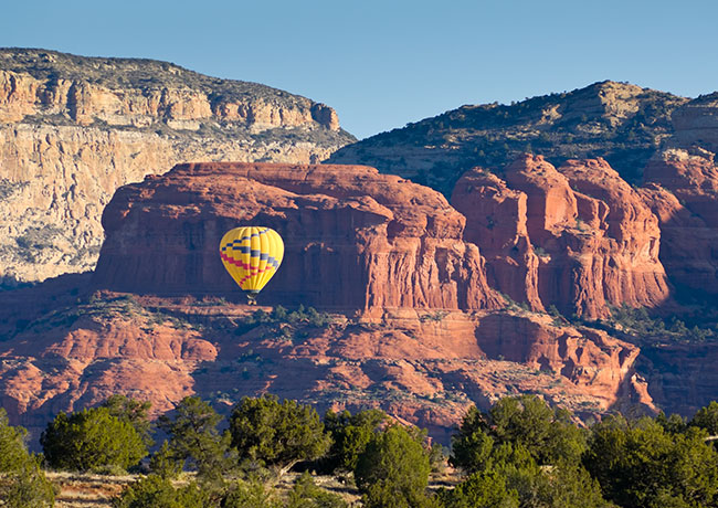 Air balloon flying through grand canyon