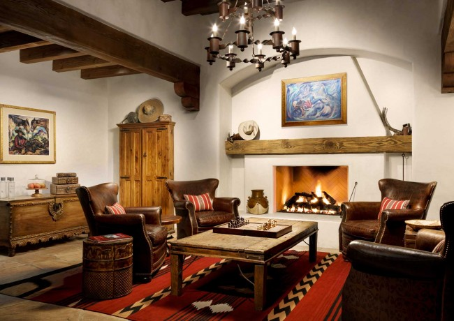 lobby with fireplace and warm rustic interior details