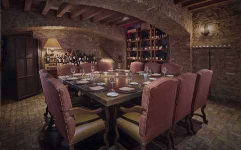 wine celler with dinner table and chairs
