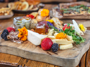 charcuterie board with fruits and chesses