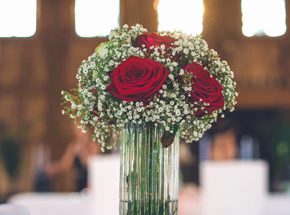 vase with red roses and babys breath