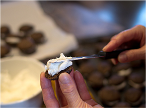 cream being spread onto whoopie pie