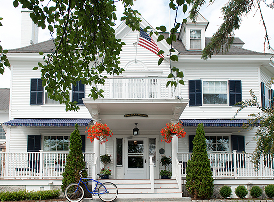 exterior of boutique hotel with a wraparound porch