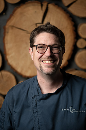 headshot of the chef smiling