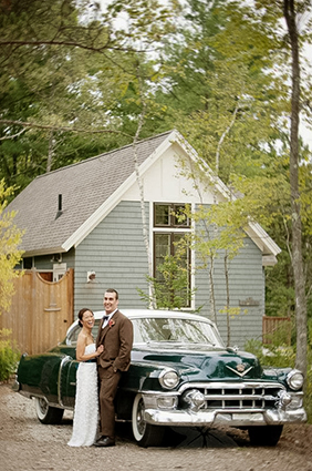 bride and groom standing by a retro car outside