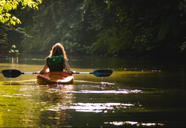 a girl enjoying a kayak