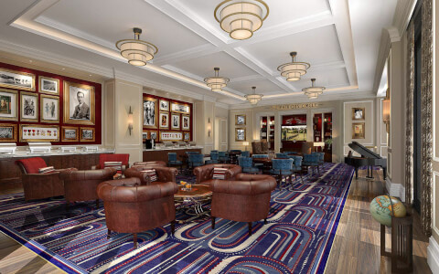 Hotel lobby area with colorful stripped rug and brown leather chairs