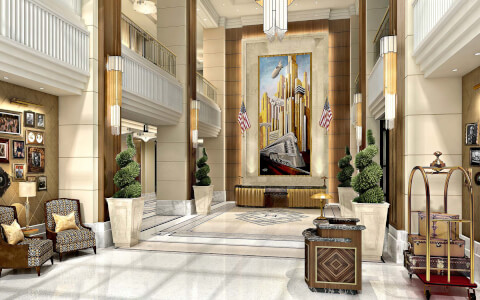 Lobby with concierge desk and large painting behind front desk