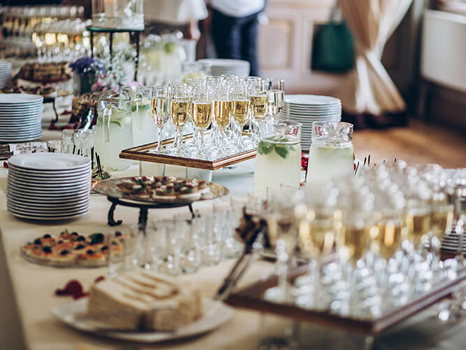 Table set with small dessert bites and champagne glasses