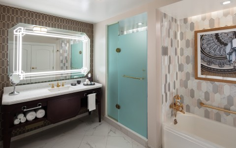 bathroom marble counter with walk-in shower and separate bathtub