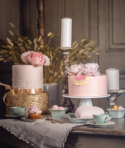 Two pink cakes on table