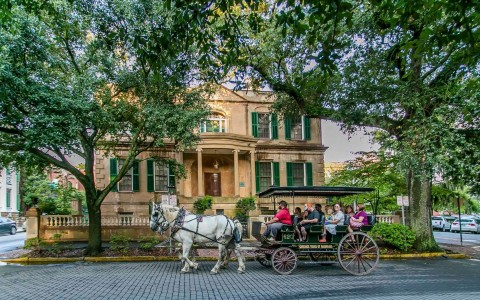 horse and carriage outside historic home
