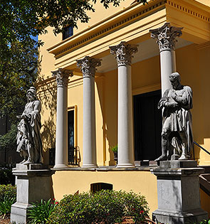 front steps of historic Savannah home framed with colomns and statues