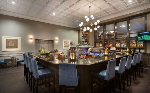 DeSoto bar is classic with modern twists. The U shaped bar has comfortable high top chairs , wood floors and decadent cielings