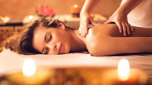 woman laying down getting a massage in the spa