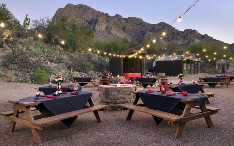outdoor table seating in desert landscape