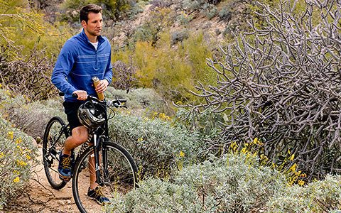 man biking in tucson wilderness