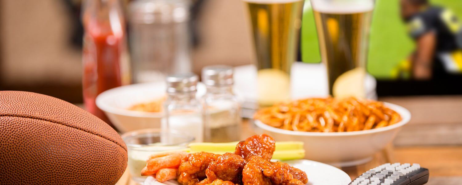 plate of chicken wings and fries