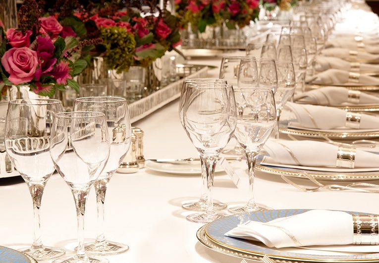 Place table settings for a wedding