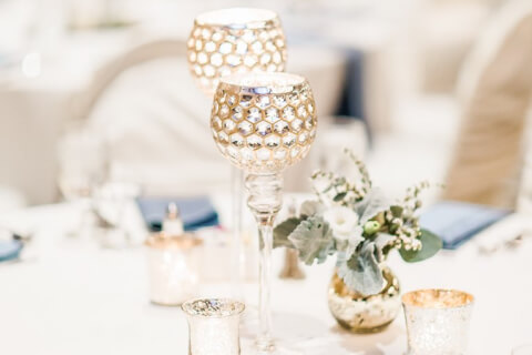 Two elegant centerpieces on a table