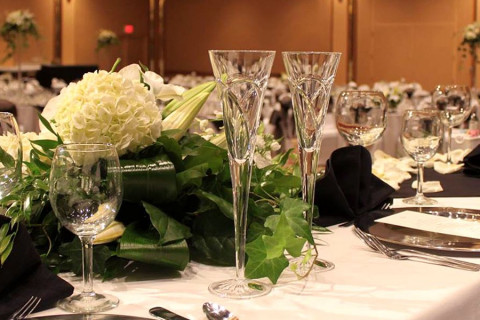 table with flowers and crystal glasses for a wedding