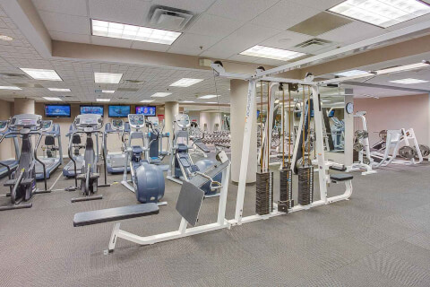 Interior gym with several pieces of equipment