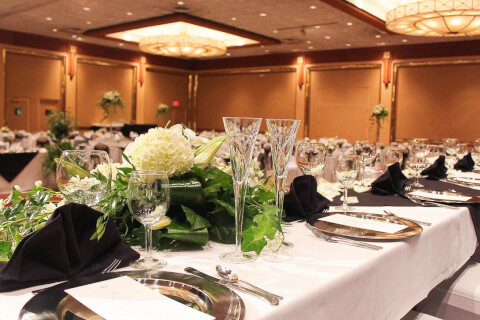 table set with flowers and crystal glasses for a wedding