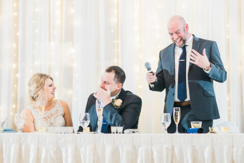 a man giving a speech at a wedding