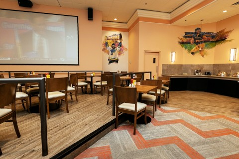 sportzone restaurant with screen showing a game