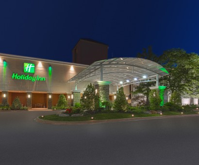 front of hotel entrance at night