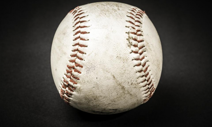 Game used baseball with black background