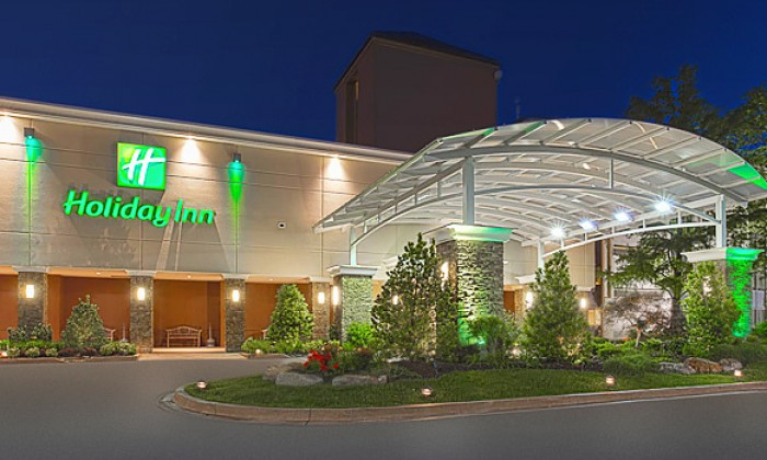 Front of Holiday Inn hotel at night