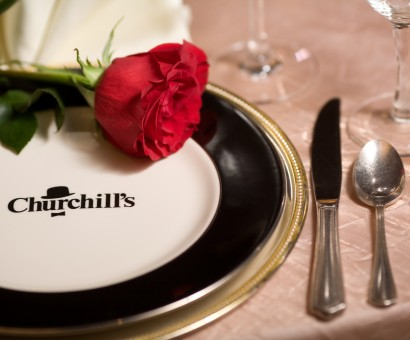 Churchill's restaurant place setting with a red rose on the plate