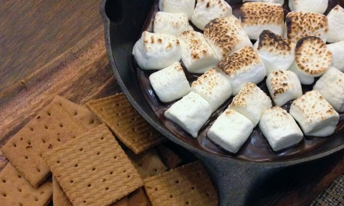Marshmallows in frying pan and graham crackers for smores
