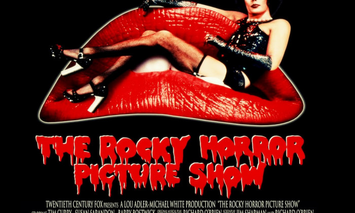 The Rocky Horror Picture Show poster with Tim Curry in costume on a couch shaped like red lips