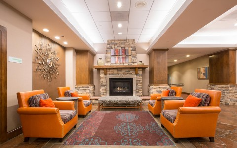 Fireplace and seating area inside of a Denver hotel