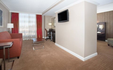 executive king suite with spacious couch area and tv