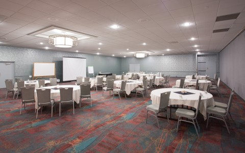 spacious events room with circular tables