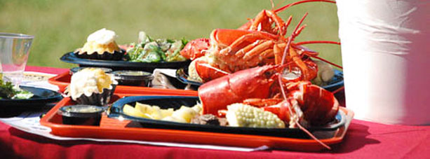Lobster served with sides on trays