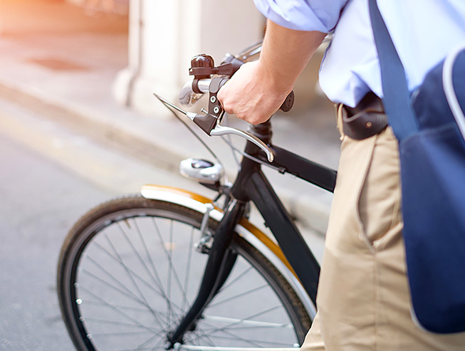 Close up of man walking bike
