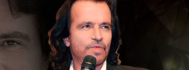 Portrait of Yanni with microphone