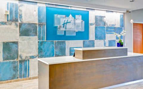 Lobby wooden front desk with rustic blue & beige tiles
