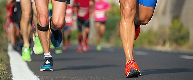 Close up of legs running in a marathon