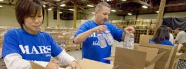 Volunteers food packing in boxes