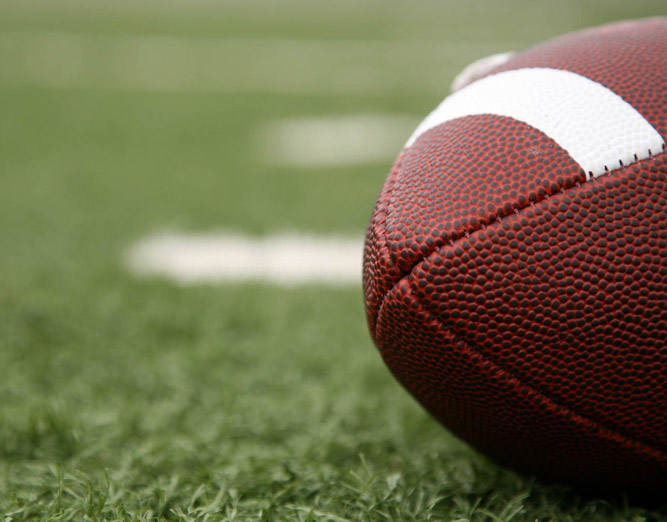 Close up of football on field