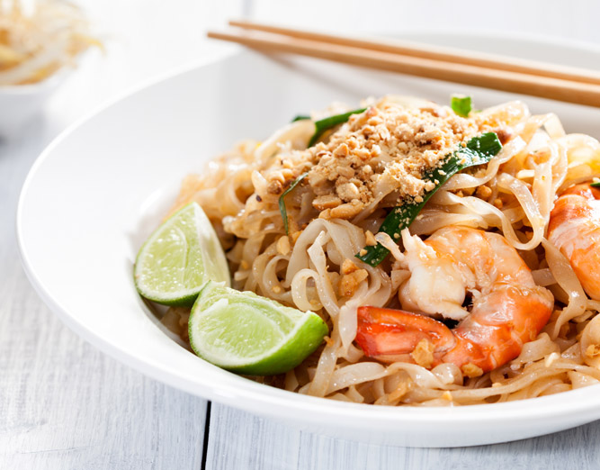 Thai noodles with shrimp & lime wedges