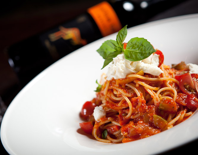 Spaghetti with red tomato sauce & topped with ricotta cheese