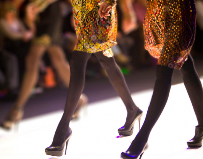 Close up of women with heels on runway