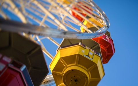 Ferris wheel with colorful seating capsules